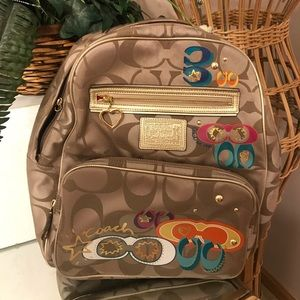 Coach gold poppy backpack